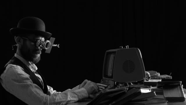 Retro Futuristic Portrait Of Man Using Computer video