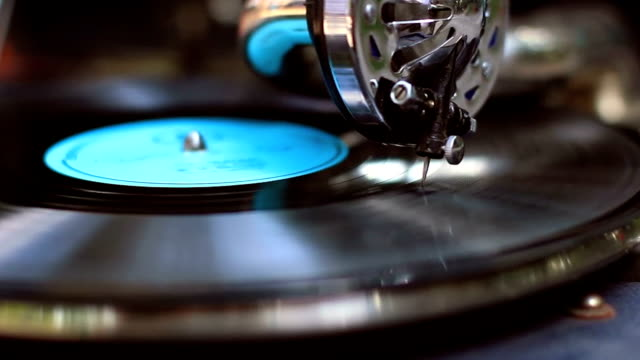 Retro gramophone playing, big fashionable needle scrapes record video