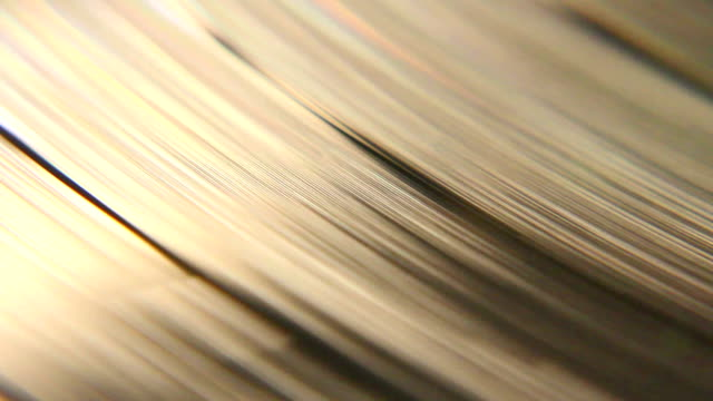 Retro Macro Vinyl Record A macro shot of a vinyl disc spinning around. grooved stock videos & royalty-free footage