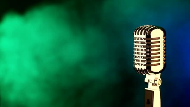 Retro microphone on green and blue