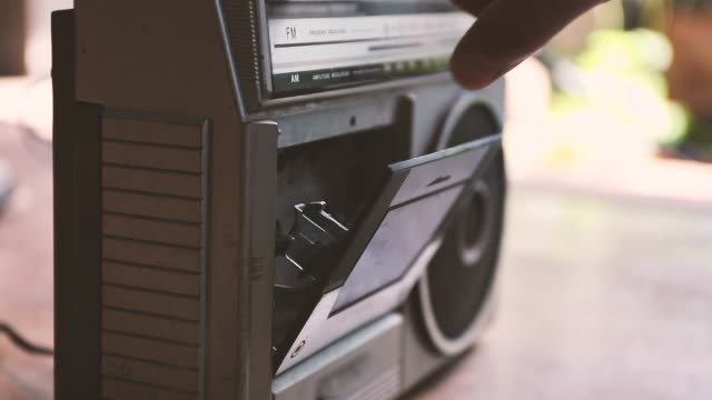 retro music player man put a cassette tape into retro music play, vintage style hip hop stock videos & royalty-free footage
