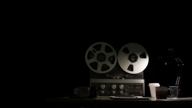 retro quarter inch analog reel-to-reel recorder being operated in a darkened room - mangianastri video stock e b–roll