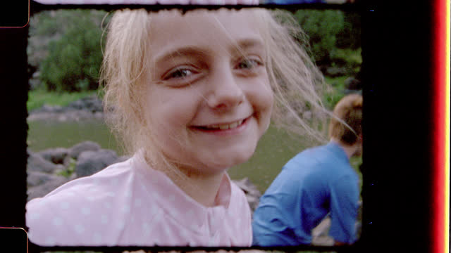 Retro style film footage of brother and sister testing the water and enjoying Black Rock Hot Springs on family camping trip.