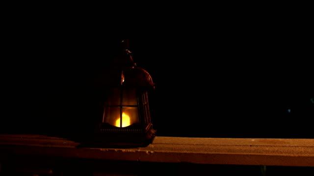 retro stil lykta på natten. vacker färgglad upplyst lampa på balkongen i trädgården. selektivt fokus - ramadan lykta bildbanksvideor och videomaterial från bakom kulisserna