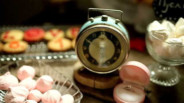 Retro table with cookies and old clock video