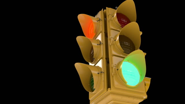 retro traffic lights against black background, driving through intersection - stoplights stock videos & royalty-free footage