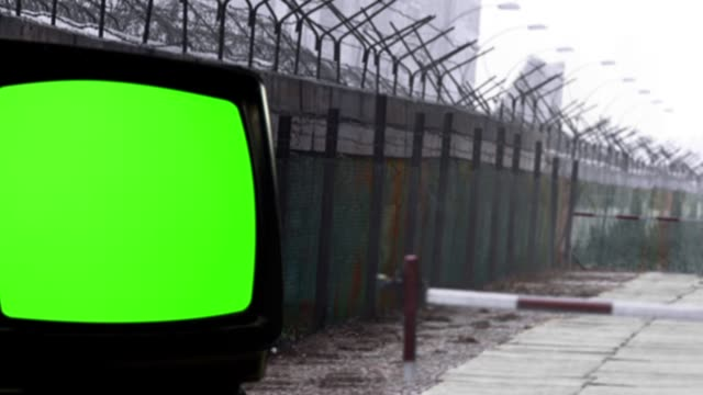 Retro TV with Green Screen and the Berlin Wall as a Background.