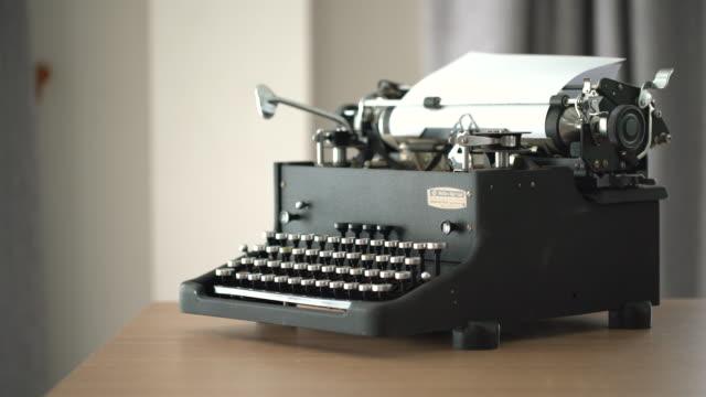 4K Retro & vintage style typewriter in studio with dolly 4K Retro & vintage style typewriter in studio with dolly: SONY A7R M2, 100 macro L Canon typewriter stock videos & royalty-free footage
