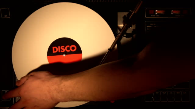 A retro-styled film look of a spinning record player 4k. video