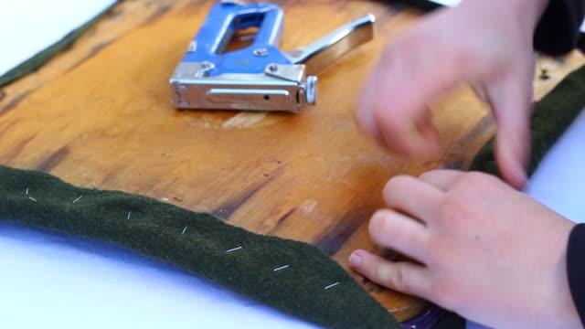 vídeos de stock e filmes b-roll de reupholstering with heavy-duty staple - chair