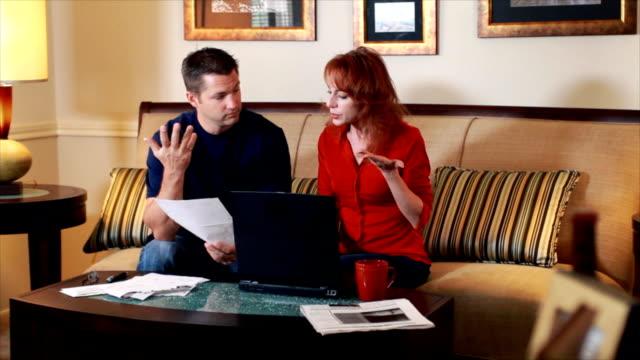 Reveal shot couple going over bills video