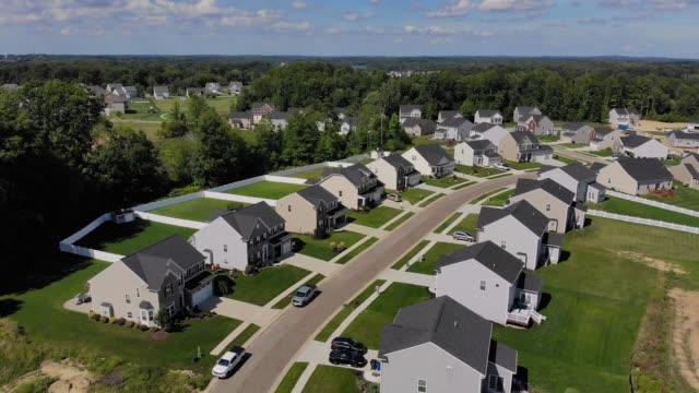 Reverse Aerial Establishing Shot of Ohio Neighborhood An aerial reverse establishing shot of a typical Ohio neighborhood on a summer day. Cleveland suburbs. modern house stock videos & royalty-free footage