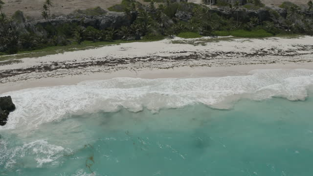 Reverse drone shot of deserted tropical beach video