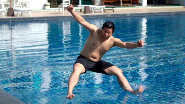 Slo Mo Reverse Jumping Into Swimming Pool Stock Video & More