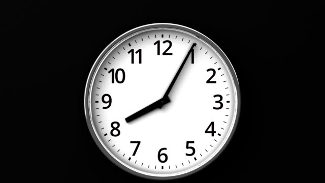 Reverse Rotation Clock On Black Wall Zoom View. wall clock stock videos & royalty-free footage