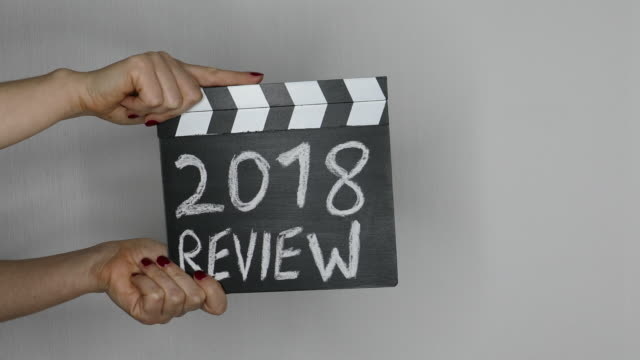 2018 review. hands holding movie clapper - 2018 video stock e b–roll