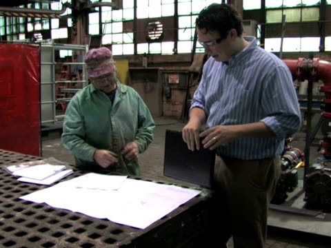 Reviewing Blueprints in Factory 1 video