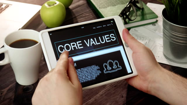 vídeos de stock e filmes b-roll de reviewing core values internet page using digital tablet - moralidade
