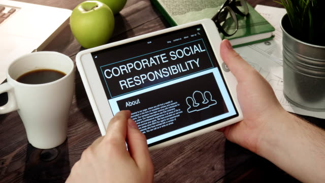 Reviewing corporate social responsibility internet page using digital tablet video