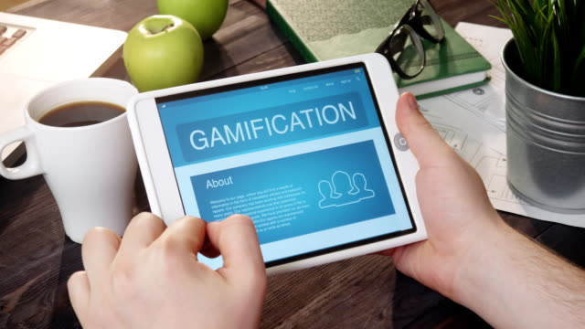 reviewing gamification app using portable computer - badge video stock e b–roll