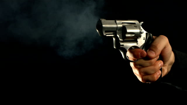 stockvideo's en b-roll-footage met revolver shooting at 1000 frames per second - gun shooting