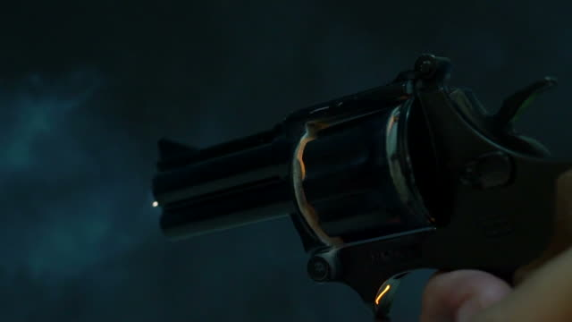 revolver shooting - fire stock videos & royalty-free footage