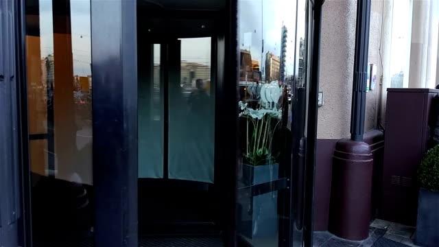 revolving door in reception of hotel - hotel reception filmów i materiałów b-roll