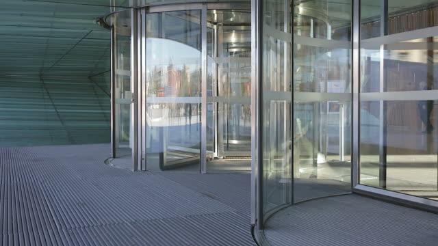 Revolving Doors Automatic Rotation Revolving Glass Door entrance stock videos & royalty-free footage
