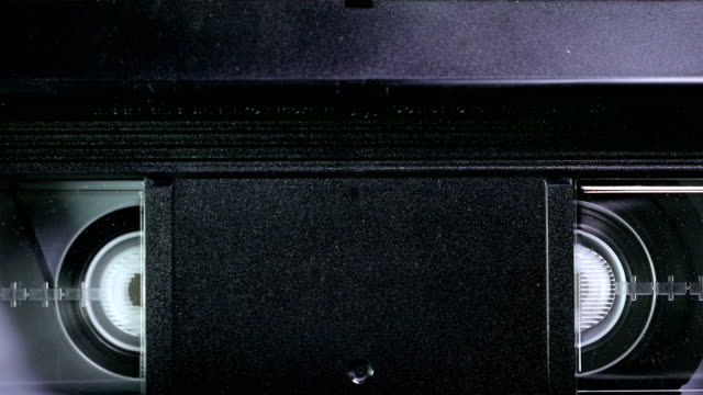 Rewind a VHS Tape into a VCR Player video