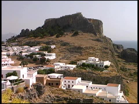 rhodes, greece: village at acropolis of lindos ruins - egeiska havet bildbanksvideor och videomaterial från bakom kulisserna