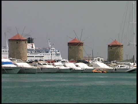 rhodes, greece: windmills at port with cruise ship and marina - egeiska havet bildbanksvideor och videomaterial från bakom kulisserna