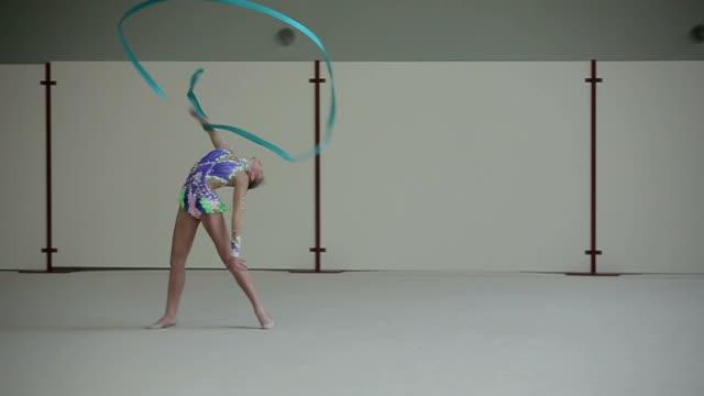 Rhythmic gymnastics: Girl training a gymnastics exercise with a ribbon video
