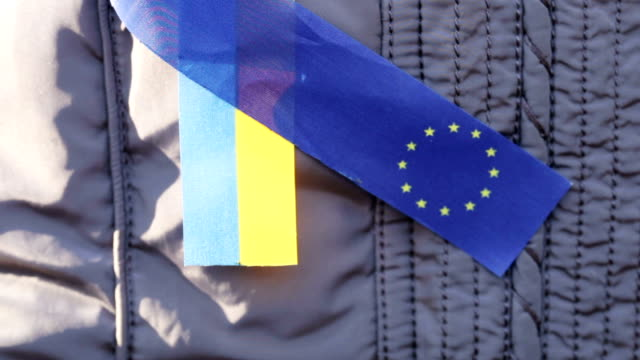 Ribbons EU and Ukraine Demonstrator with ribbons EU and Ukraine police meeting stock videos & royalty-free footage