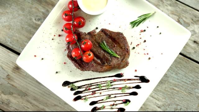 Ribeye steak top view. video