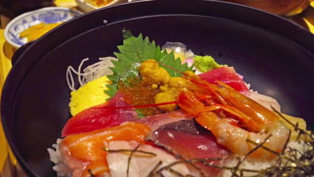 Rice bowl with raw fresh sashimi fish Rice bowl with raw fresh sashimi fish sashimi stock videos & royalty-free footage