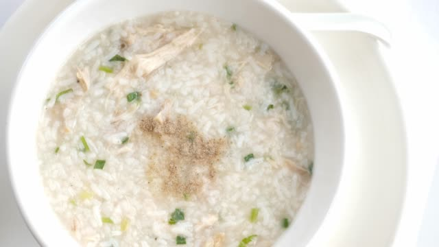 Rice porridge boiled with chicken.Top view rotating.