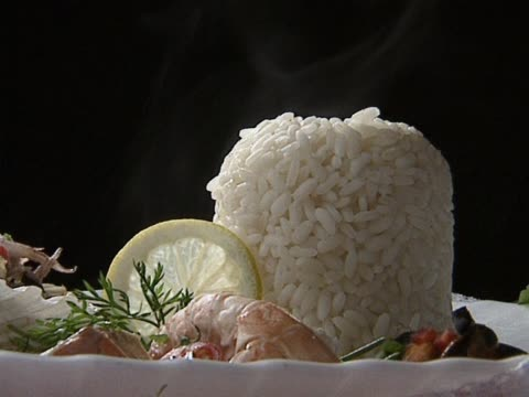 Rice with seafood on plate video