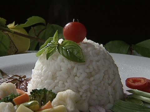 Rice with vegetable on plate video