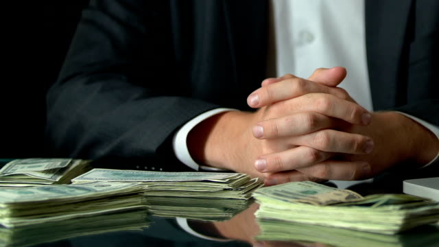 Rich businessman sitting in front of dollar bundles, growth of deposit interest