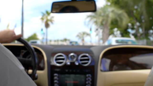 Rich male driving expensive car down road in luxury resort city, millionaire Rich male driving expensive car down road in luxury resort city, millionaire luxury car stock videos & royalty-free footage