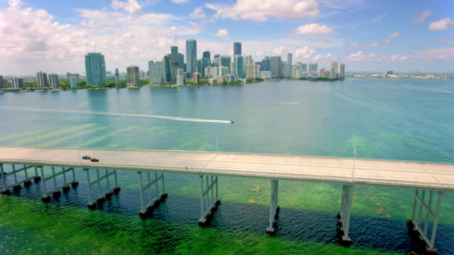 AERIAL Rickenbacker Causeway across the Biscayne Bay with Miami skyline