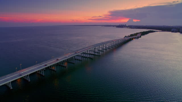 AERIAL Rickenbacker Causeway in Miami at sunset