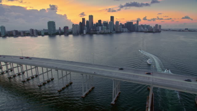 AERIAL Rickenbacker Causeway with Downtown Miami at sunset