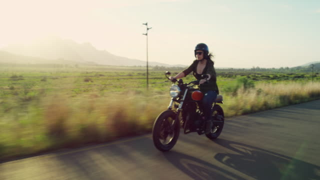 Ride and explore more 4k video footage of a young woman riding her motorcycle on the open road motorcycle stock videos & royalty-free footage