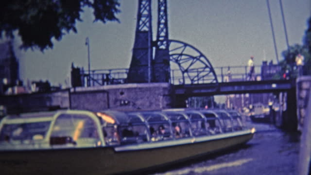 1969: Ride on boating canals and past classic bridges. video