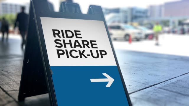 ride sharing pickup location directional sign - rideshare stock videos and b-roll footage