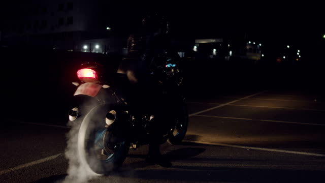 Rider on streetbike burning rubber.