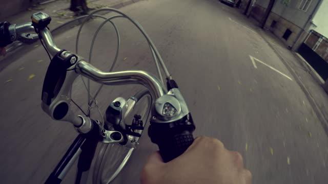 Riding a bike A man riding a bike through the city handlebar stock videos & royalty-free footage