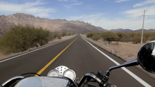 Riding a motorcycle on an open road video