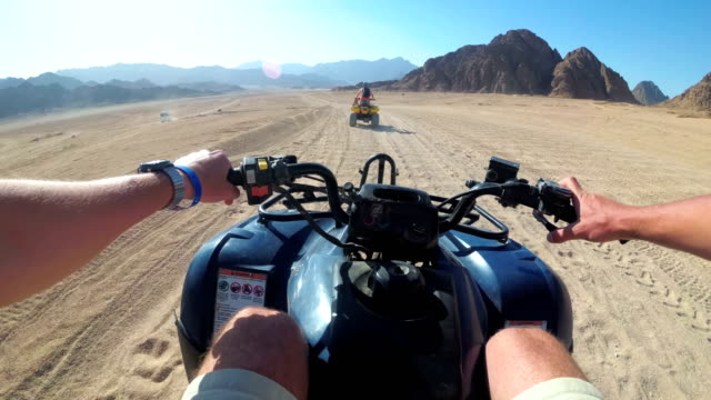 Riding a Quad in the Desert of Egypt. First-person view. Rides ATV bike